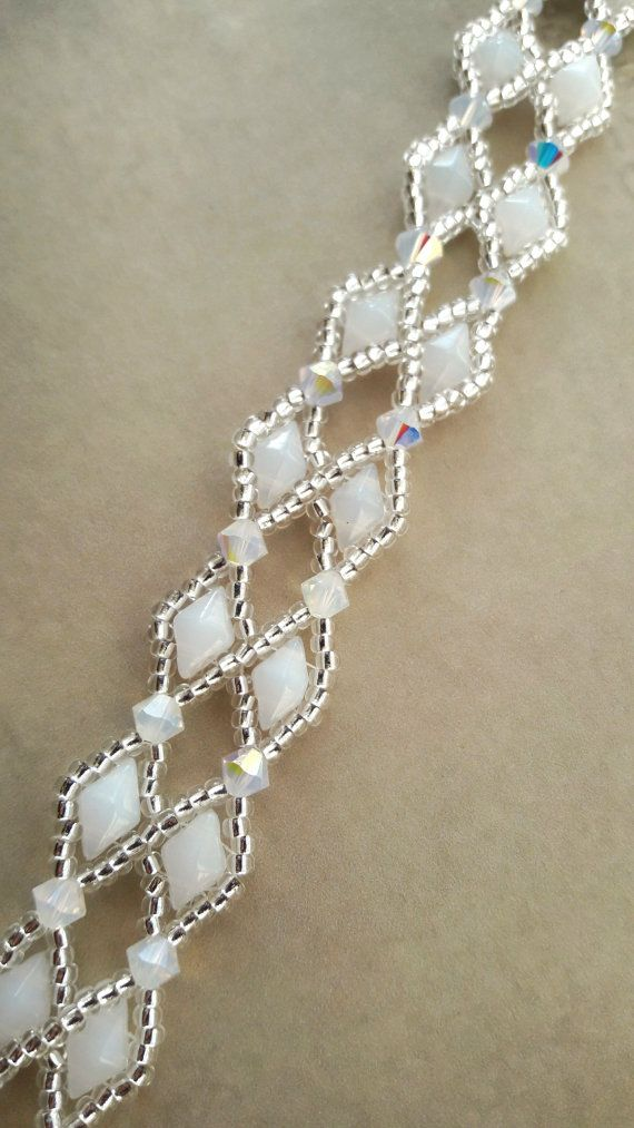 White opal diamond beaded lattice crystal lacy bridal wedding bracelet using Swarovski crystal elements. Genuine Swarovski aurora borealis coated White Opal colour crystals surrounded by a handsewn net of silver-lined clear crystal seed beads and White Opal coloured glass diamond