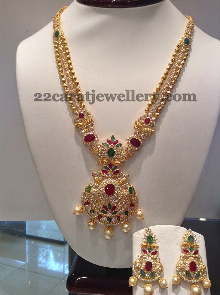 Two layers of 22 carat gold small beads and uncut diamonds layer triple step long chain with two step designer floral pendant. Round CZ s...