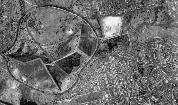 "This aerial from the early 1930s shows the York Road extension that cut Queens Park from Centennial Park. Queens Park is still rather underdeveloped. ""Tuckers Sandhill"" is the large area of white sandy ground is where the hospital was built."