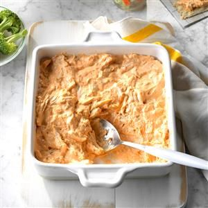 Easy Buffalo Chicken Dip Recipe -Everyone will simply devour this savory and delicious dip with shredded chicken throughout. The spicy kick makes it perfect football-watching food, and the recipe always brings raves. —Janice Foltz, Hershey, Pennsylvania