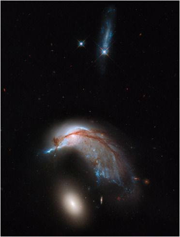 They Call It the Penguin: Hubble's Amazing Photo of Galaxies Colliding