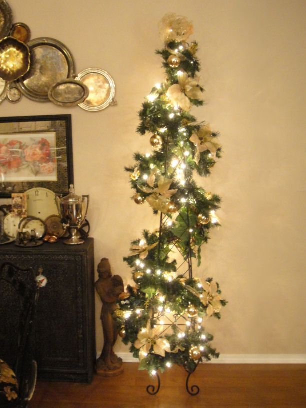 ALTERED ARTIFACTS  ~This will be my Christmas tree this year, decorated with wings!