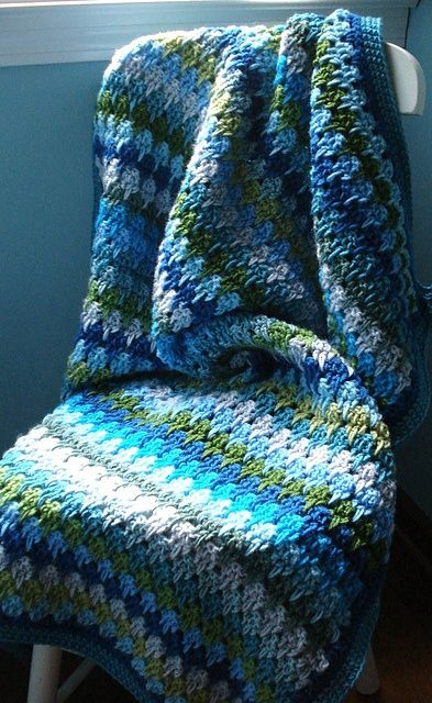 Ravelry: lyndamk's Oceana Larksfoot blanket. Free crochet pattern (video and diagram!) I love the watery colors in this.