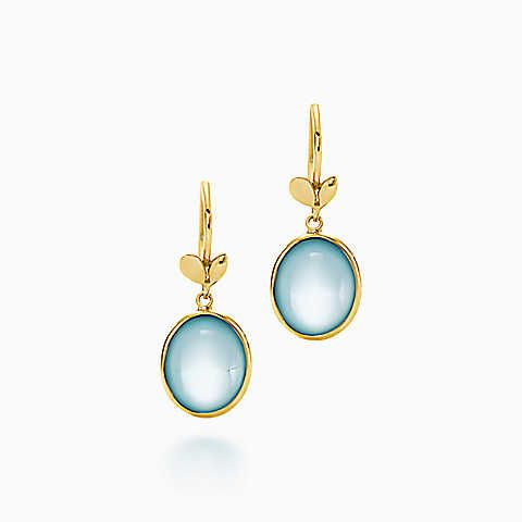 Paloma Picasso® Olive Leaf drop earrings in 18k gold with blue topazes. | Tiffany & Co.