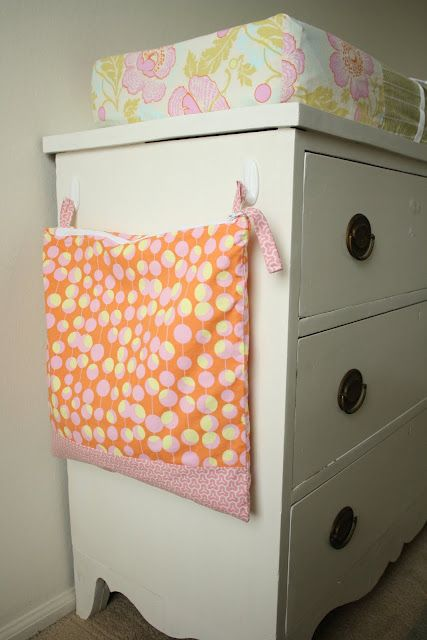 Wet Bag.  Good idea to use command strips for a dirty clothes bag in the nursery.