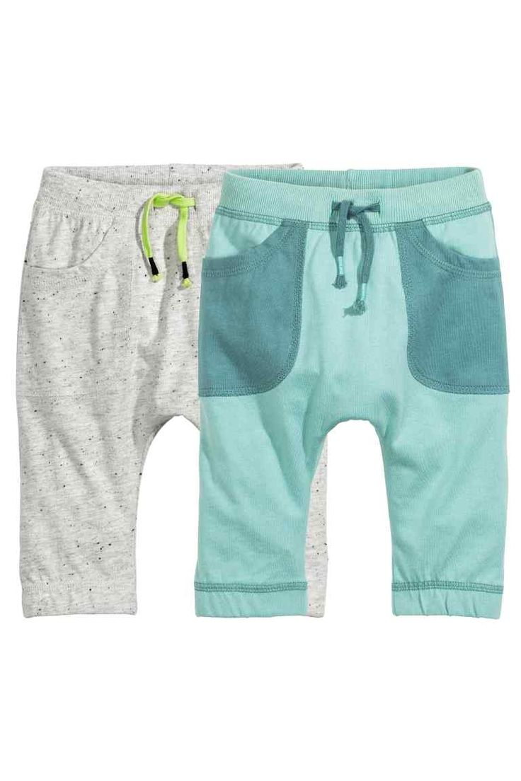 2-pack jersey trousers: Trousers in soft cotton jersey with an elasticated drawstring waist and side pockets.