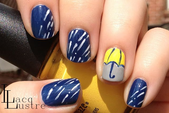 Nail art manicure for a rainy day. Love the little umbrella on the one nail...I wonder if that one didn't take as long to dry...