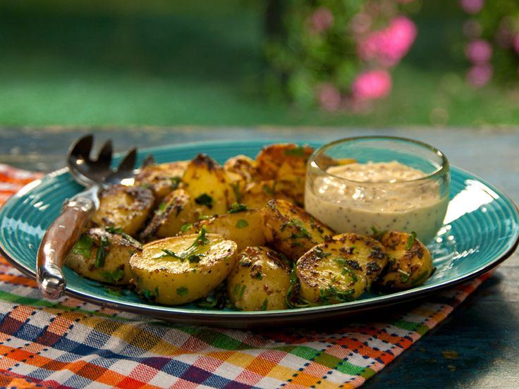 Mustard Aioli Grilled Potatoes with Fine Herbs from Food Network.  Curt' s made this twice and it's great!