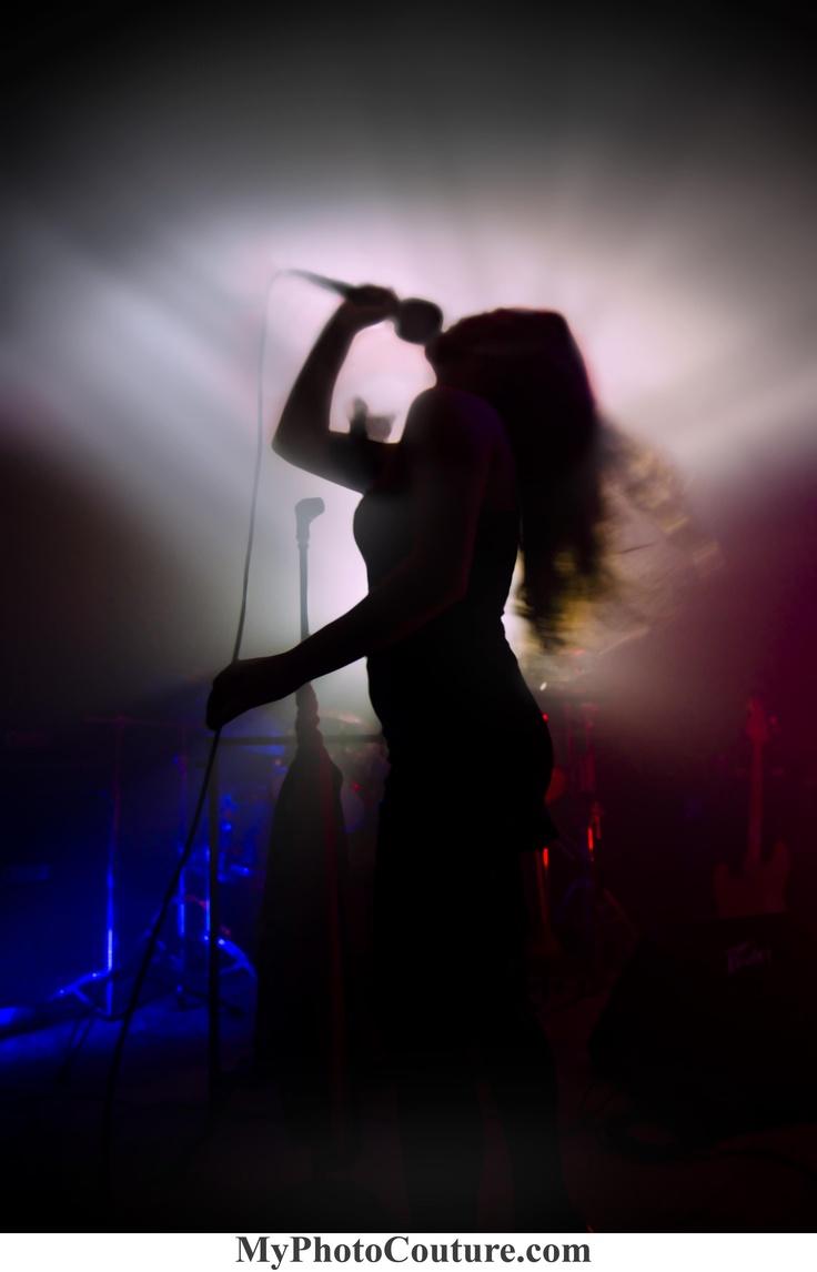 Girl Singing Into Micr...