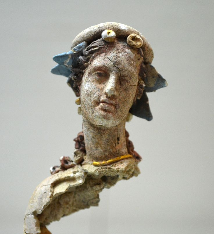 """Archaeological Museum of Chania: """"Teracotta figurine of a woman, which preserves its bright colors and gold-plated jewelry. It was found in the ancient graveyards of Kydonia (present Chania). Early Hellenistic period. It's probably connected to an..."""