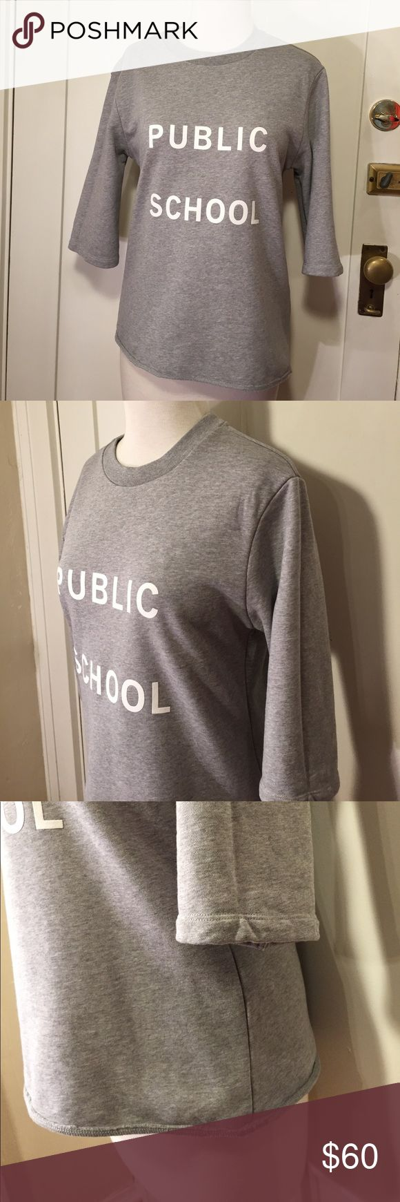 Public School New York gray logo sweatshirt This is a comfortable gray sweatshirt from Public School New York, light gray with front graphic, cropped sleeves. Bust 38 inches, shoulder width 17 inches, full length 24 inches. See pictures for details. Good condition. Be sure and check out other items in closet and bundle to receive discounts. Public School Tops Sweatshirts & Hoodies