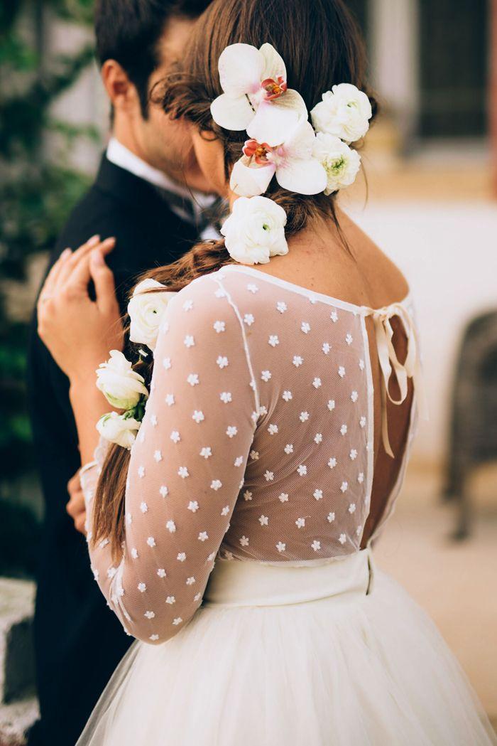Flowers in her hair + Laveda Bridal wedding dress   Image by  Weddings by Sasa Tomic