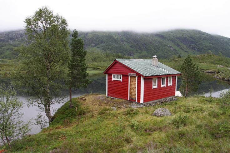 Red cabin, green hills, blue lake. Norway. Paradise.