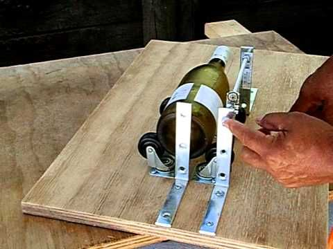 I made this bottle cutter different from others home made bottle cutters. This one has a rod were the glass tool slide along, making this one more versatile.