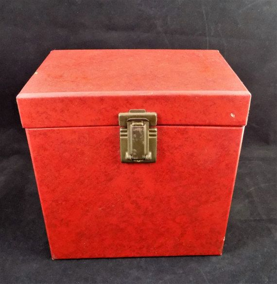 Red Amfile Case, 45 Record Case, Holds 50 Size 45 Records, Model 705 Measures 7 1/2 long, 7 1/2 tall, and 5 wide.  Complete with 50 numbered card stock separators. Index card, partially filled out in pencil for records owned.  Leatherette finish, as it was called. Made perfectly to fit 45 records inside for personal use.  Also contains an original tag and information slip on other Amfile models.  This one had been used for RPM records. Made of binders board. Not mint, has a couple o...