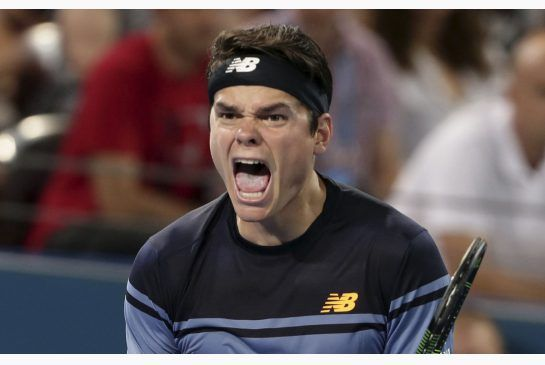 Canada's Milos Raonic reacts after winning the Brisbane International final against Roger Federer 6-4, 6-4 Sunday, Jan. 10, 2016.