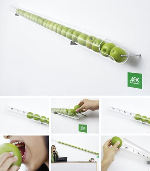 """The """"Apple-a-Day"""" calendar from AOK Heath Insurance (Germany). The company offered this amazing dispenser shaped wall calendar, which is a long clear tube that holds up to 31 apples. Every day you remove one apple from the tube and eat it, thus giving a boost to your health. """"An apple a day keeps the doctor away."""" Brilliant!"""