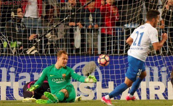 Spanish La Liga: Barcelona fall to shock Malaga defeat after Madrid derby draw