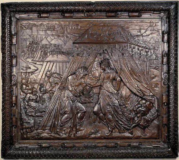 """Judith et Holopherne, 1570, chêne (taillé, bas-relief) m 1.25x1.45. Doré à l'origine, puis décapé. Les personnages représentent un canon assez étiré, le style mouvementé tend vers le manièrisme. Les paysages urbains, d'un """"scacciato"""" tout italien, trahissent cependant, par leurs clochers pointus, une main française. L'encadrement, avec sa bordure de cuir découpé assez sèche et son gros tore décoré de """"lumachi"""", est moins habile. Rouen; musée départemental des Antiquités de la Seine-Maritime."""