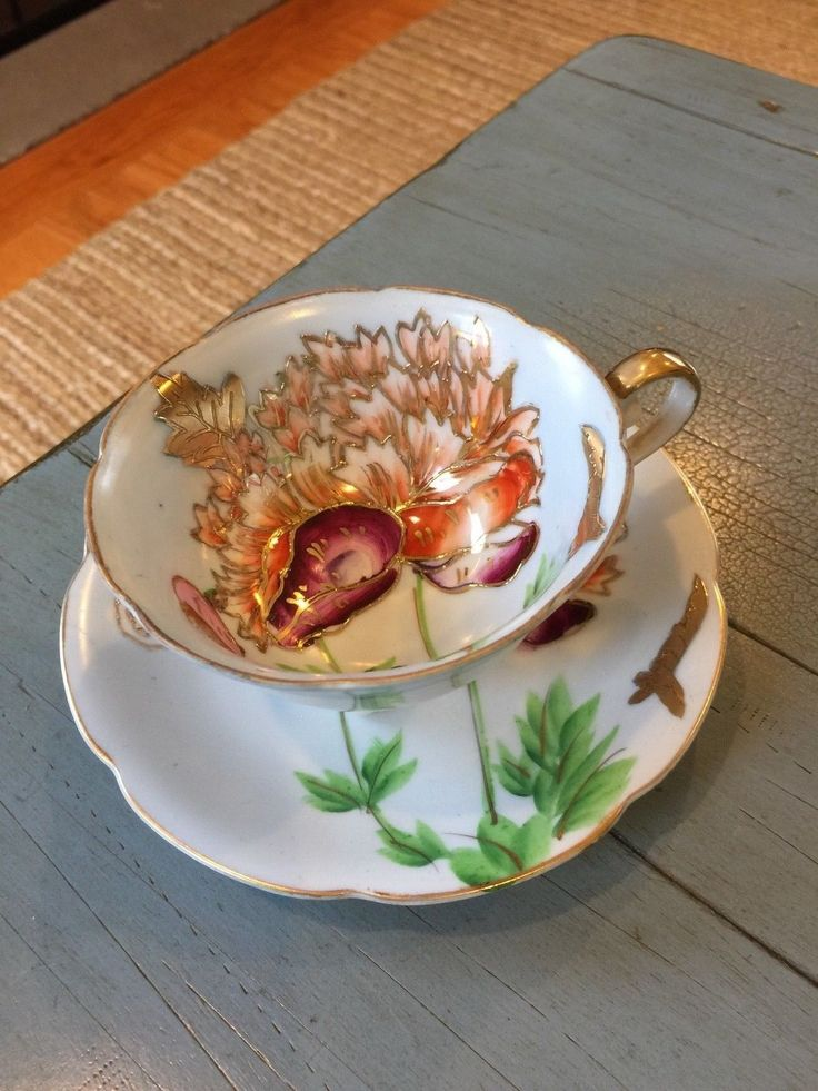 SAJI Tea Cup and Saucer Made In Occupied Japan Light Blue Floral Footed - CAD $17.96. This listing is for a beautiful teacup and saucer made in Occupied Japan by Saji. The cup has pretty floral and gold designs. The footed cup measures 2 1/4 inches tall, and the saucer is 5 1/2 inches across. The set is in good, vintage condition with some wear to the paint in places. Please see my other teacup listings. Thank you! 232684701703