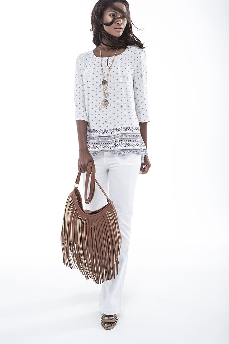 Carefree boho - printed boho blouse worn with SS15 trend slim flare denims. #miladys #denim #whiteonwhite