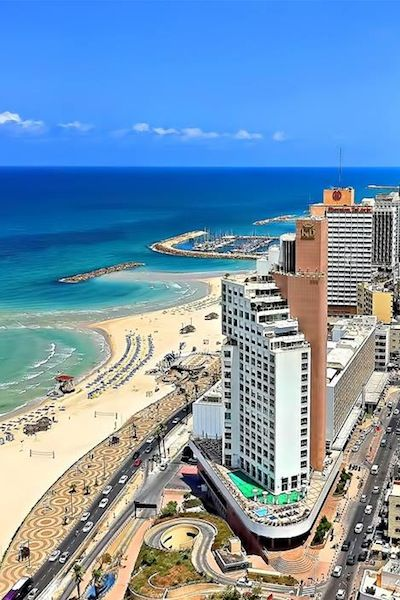 Tel Aviv, Israel. The history of the Middle East with the today's incredible night life. And look at that beach!