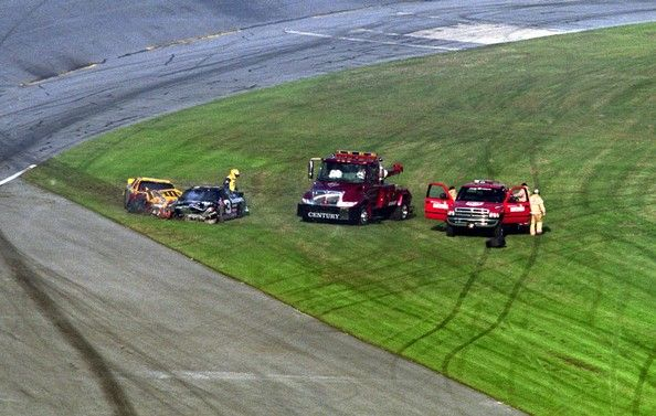 18 Feb 2001:  Ken Schrader walks around the accident scene that took Dale Earnhardt's. life at the  end of the Daytona 500, he said when he got out of his car he expected Earnhardt to be yelling at him, but when he looked in the car, he knew Dale was in big trouble. #DaleEarnhardt  http://www.pinterest.com/jr88rules/death-of-a-champion/
