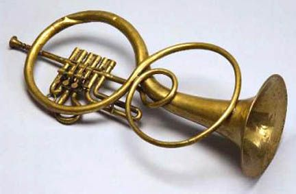 """""""This is  a Schneider tenor horn... [which} is an example of the """"flugel"""" instruments popular in the early 1800s... Many of these instruments predate or were pretty much identical to certain of the Saxhorns, especially the Eb and Bb baritone flugles that were configured pretty much like saxhorns."""" rugs-n-relics.com"""