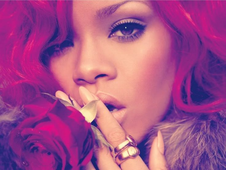 inger Rihanna appeared to have ditched her black locks and was spotted with flowing red hair in her music video. GetANews.com