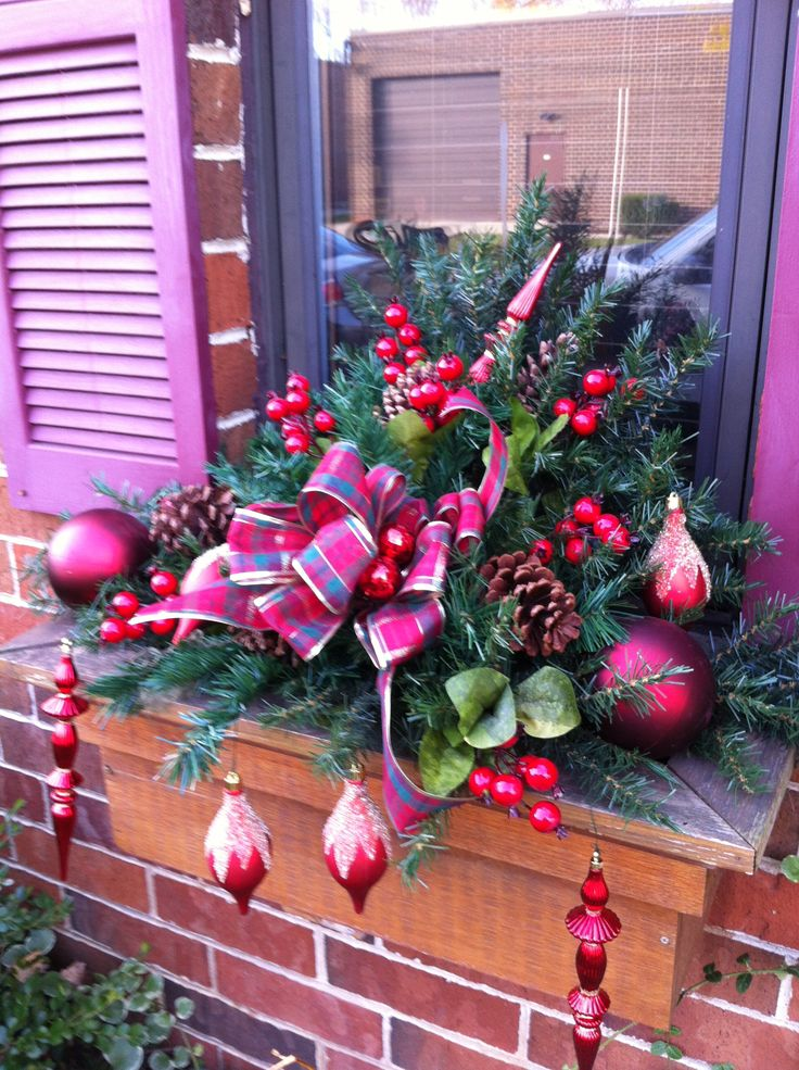 Window box sprays made from recycled artificial Christmas trees.