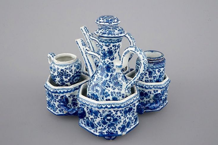 An exceptionally extensive Dutch Delft blue and white cruet set, 18th C.