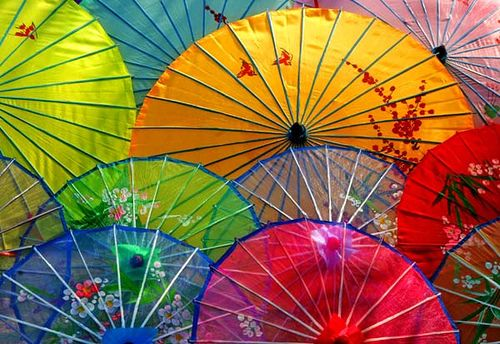a street vendor displays an abstract of chinese umbrellas.