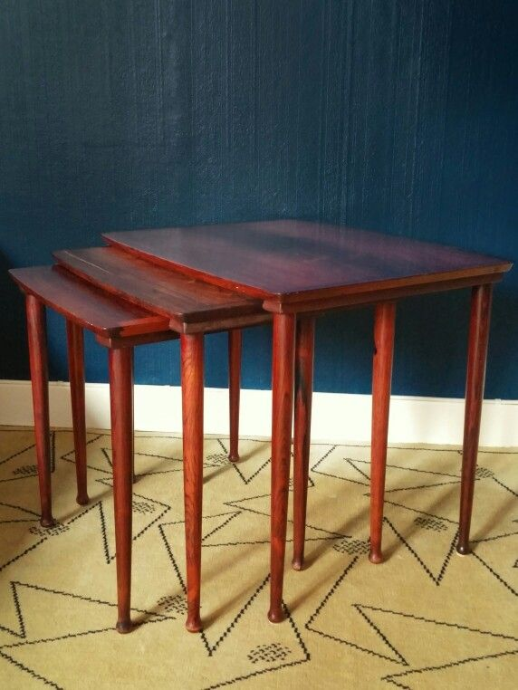 nesting tables in rosewood. designed and manufactured in norway.