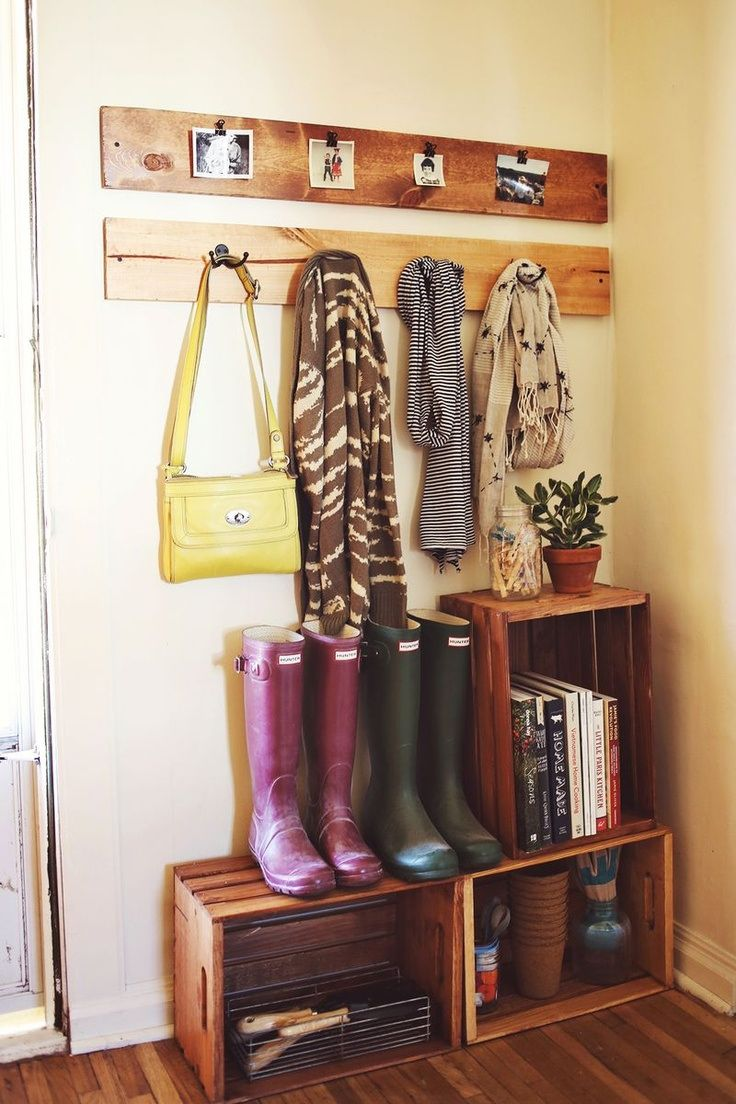 Impromptu mud room. Create a mudroom in an area that is not defined to be a mudroom with some crates and some wood planks.