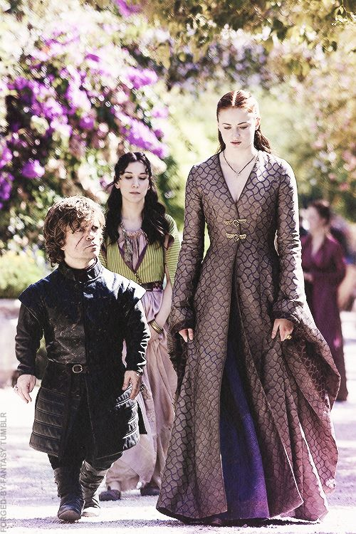 Sansa Stark wearing a third violet dress. The dragonfly buckles are present again, as well as the pendant (fragile winged creatures motif).