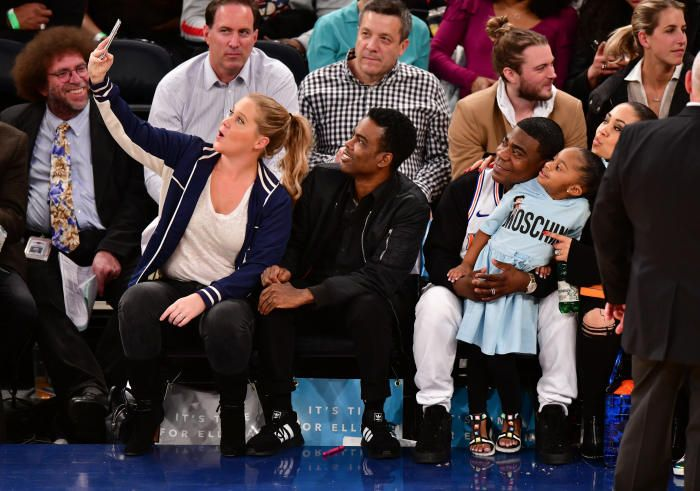 Amy Schumer, Chris Rock, Tracy Morgan, Maven Morgan and Megan Wollover attend the New York Knicks Vs Golden State Warriors game at Madison Square Garden in New York City on Feb. 26, 2018.