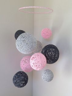 Marbled baby pink, marbled light grey, and dark grey yarn ball baby mobile