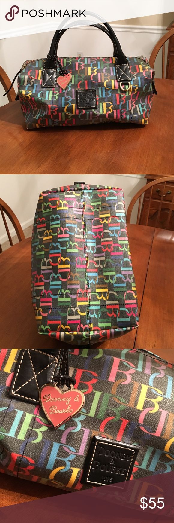 Large Multi color Authentic Dooney and Bourke Black multi color Dooney. Lightly used and in very good condition! Multi colored zipper as well! 12.5 L x 7.5 W X 8 H Dooney & Bourke Bags