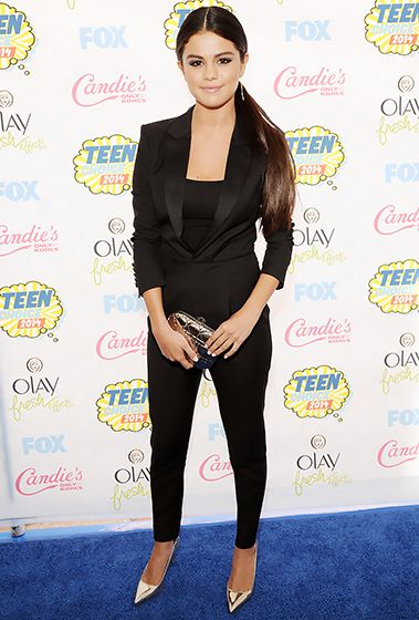 Selena Gomez looked chic in a black tuxedo with cigarette pants and metallic heels at the 2014 Teen Choice Awards.