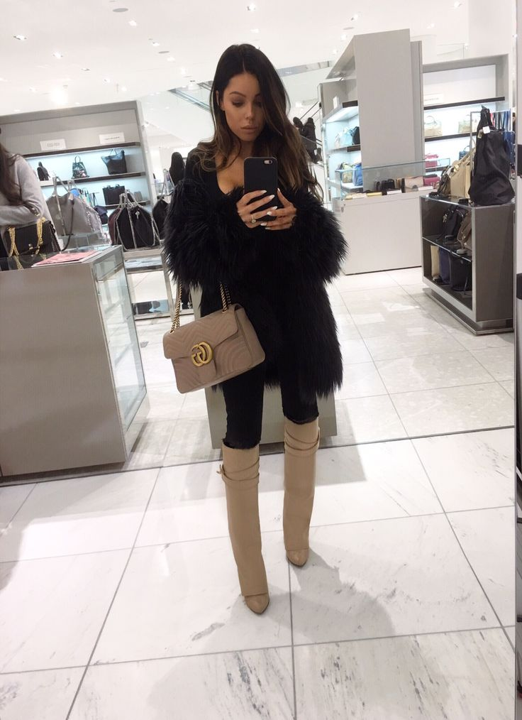 @nicole_courchaine Gucci marmont bag, givenchy boots, lioness faux fur jacket