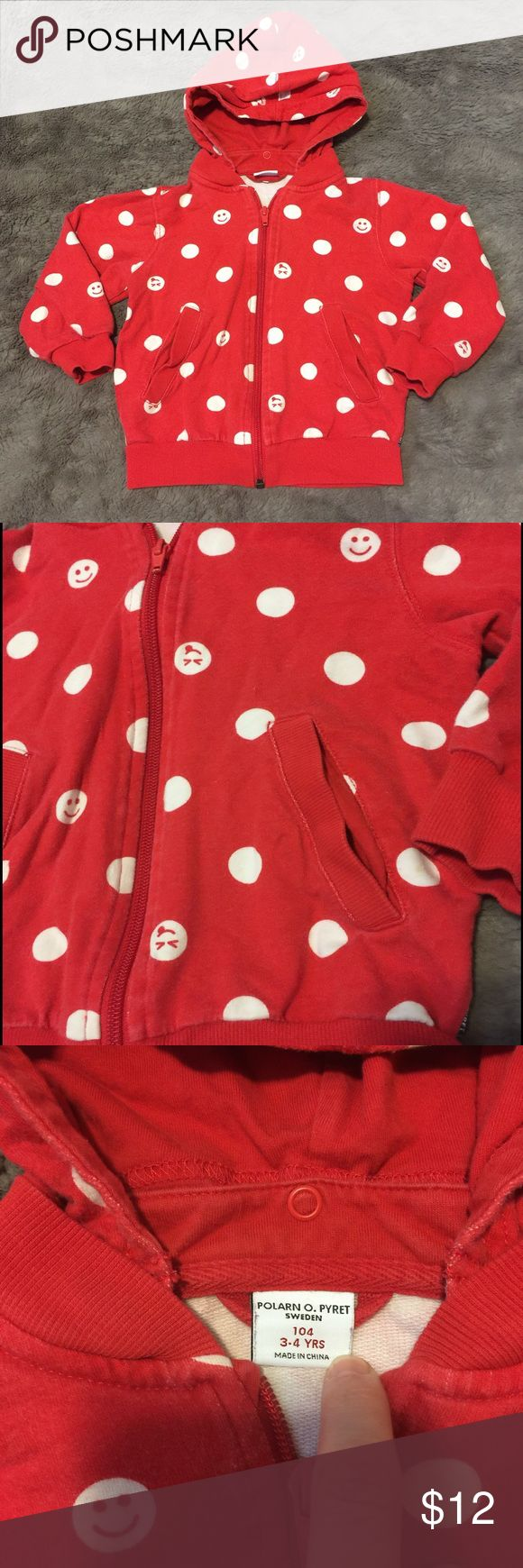 Polarn O. Pyret Polka Dot Hoodie Red cotton hoodie with white polka dots and smiley faces from fabulous eco friendly Swedish line Polarn O Pyret. Hood is removable via snaps. Size 3-4, but runs a tad closer to a 3 IMO. Gender neutral. ⭐️⭐️⭐️Please note: This hoodie has light-moderate wash wear and some scratched paint on the zipper. In good used condition overall with lots of life left! Polarn O. Pyret Shirts & Tops Sweatshirts & Hoodies