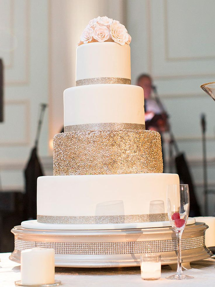 Highlight your white wedding cake with a single glitter-covered tier that packs a punch of glamour.