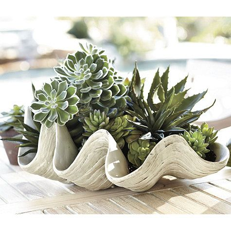 Use this giant clam shell to ice down beverages for a beach themed party indoors or out.  Ballard Designs.com $139