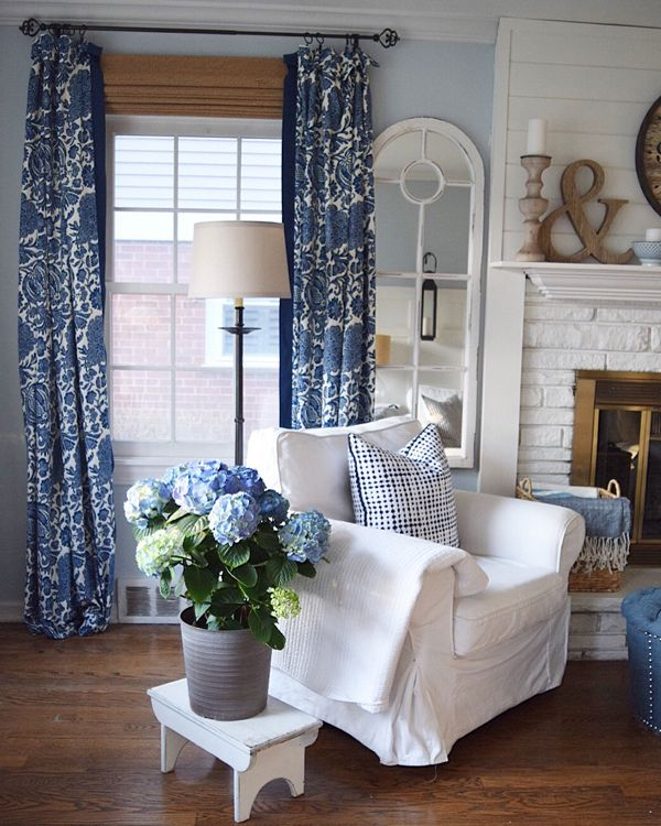 White Bold Blue Curtains Pale Walls A Few Large Decor Pieces