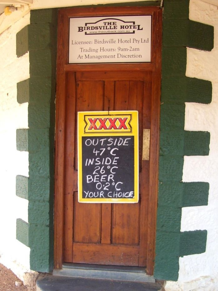 Tempting, almost compulsory!!  Sign outside the Birdsville Hotel in far west Queensland