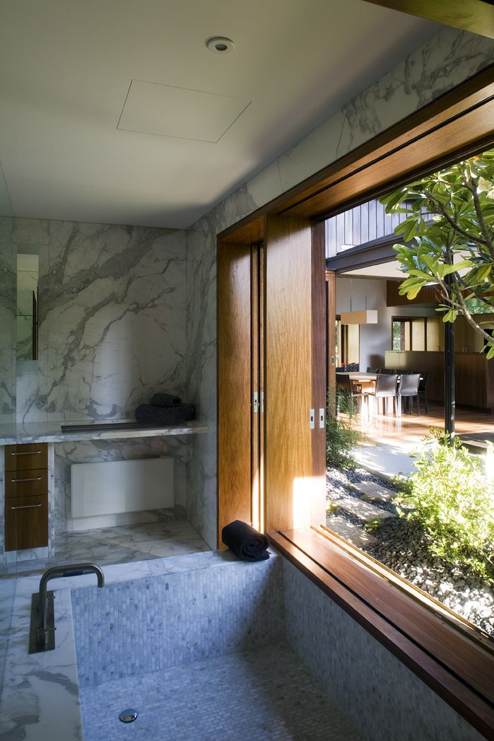 Samford House: Marble bathroom with bespoke timber window frame. See more at http://blighgraham.com.au/projects/samford-house-1