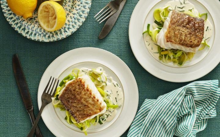 Succulent cod with a crispy skin, served with leeks and a creamy ...