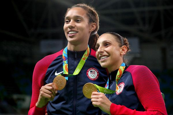 (L-R) Gold medalists Brittney Griner #15 and Diana Taurasi #12 of United States celebrate during the medal ceremony after the Women's Basketball competition on Day 15 of the Rio 2016 Olympic Games at Carioca Arena 1 on August 20, 2016 in Rio de Janeiro, Brazil.