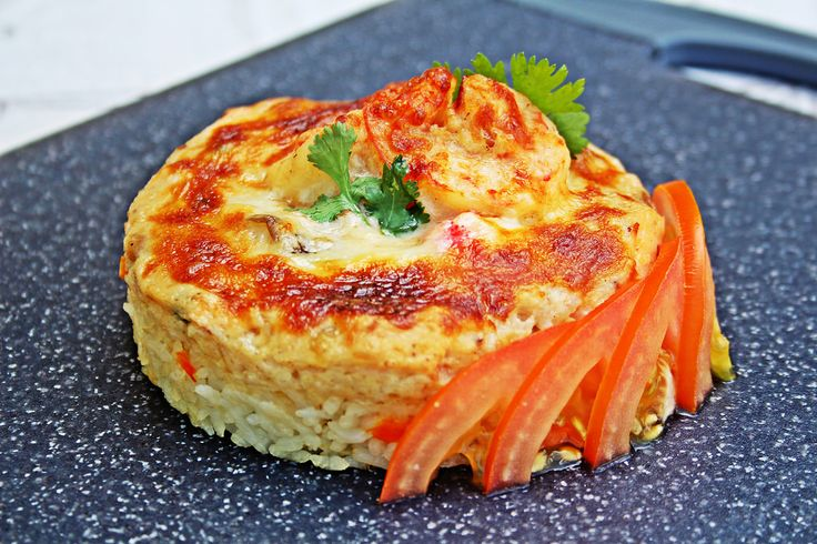 https://flic.kr/p/tEdhJx | Seafood Doria シーフードドリア [1/2] | Doria is essentially a western-inspired Japanese dish.   The rice was cooked with carrots and onions in a light stock. Included in the bechamel sauce were prawns, salmon, squid, crabsticks, shimeji mushrooms and onions. Added a generous sprinkle of mozarella and into the broiler until you get a bubbling golden top.