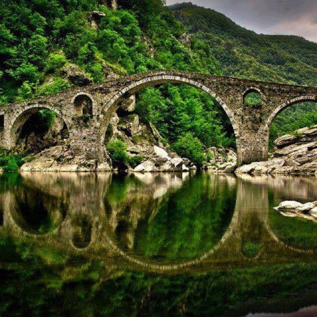 "The ""Devil's Bridge"" (Bulgarian: Дяволски мост) is an arch bridge over the Arda River situated in a narrow gorge. It is is part of the ancient road connecting the lowlands of Thrace with the north Aegean Sea coast. The bridge, the largest and best known of its kind in the Rhodope Mountains, is 56 m (183.7 ft) long and has three arches, but also features holes with small semicircular arches to read water level. #bulgaria #bulgarian #devil #devils #bridge #mountain #river #rhodopes #nature"